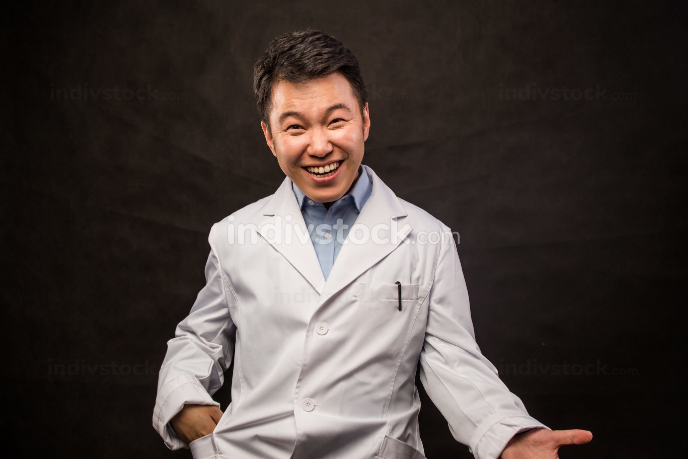 Asian doctor. Mature Chinese male medical doctor standing isolated on white background. Handsome Asian model portrait.
