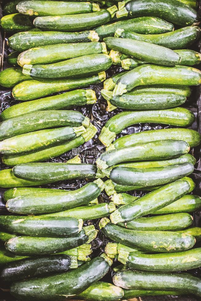 green cucumbers on shelf supermarket