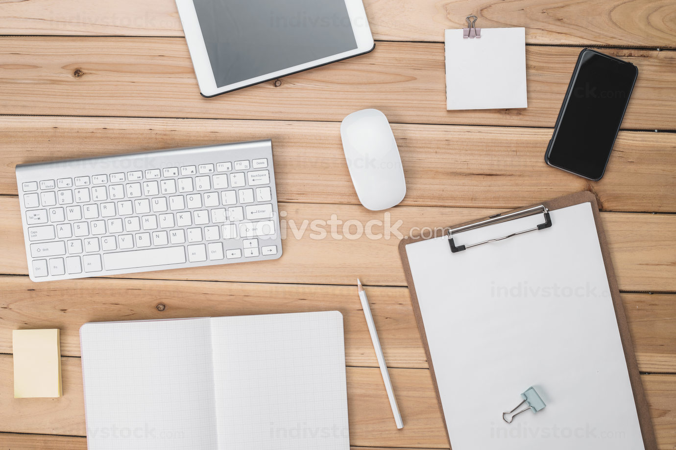 Top View of Modern Technology working Place on wooden Office Desk with large Desktop Computer Coffee Mug Keyboard and Mouse green Flower Notepad and Pen