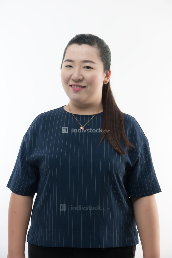 Young woman posing and smiling over white background
