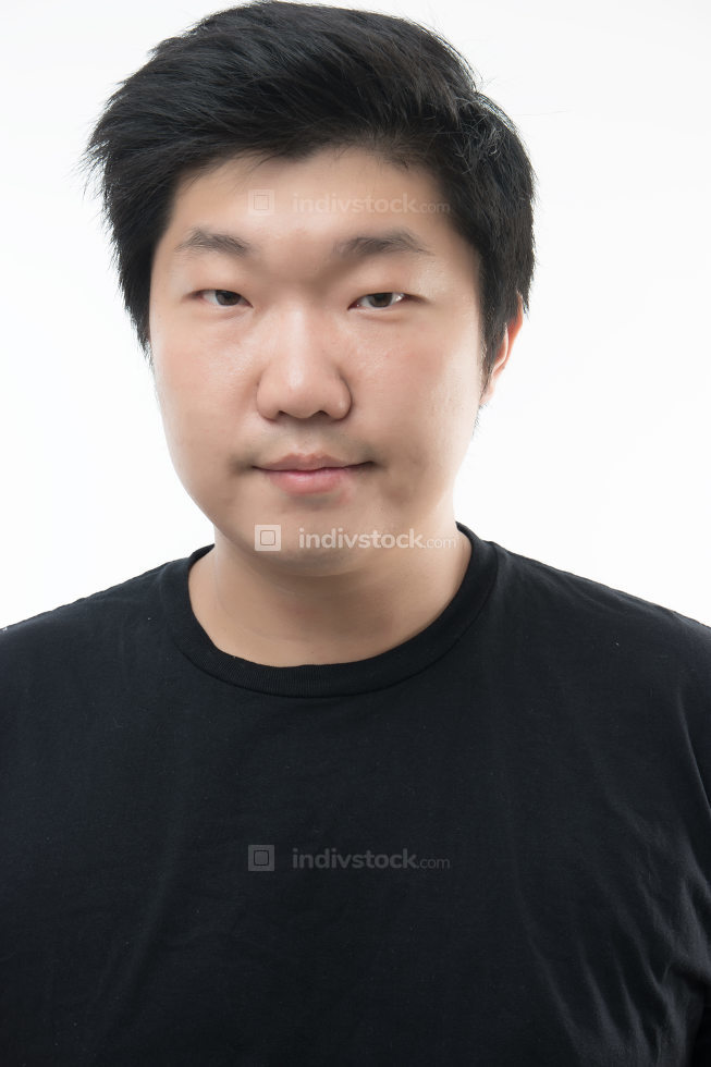 Young man posing and smiling white background portrait on white background
