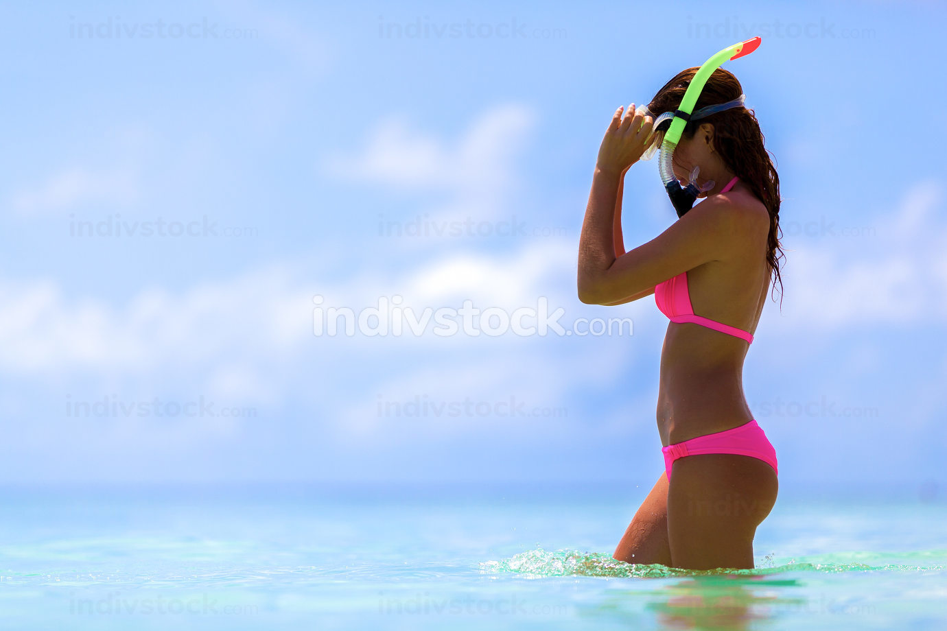Maldives a woman with a snorkel mask