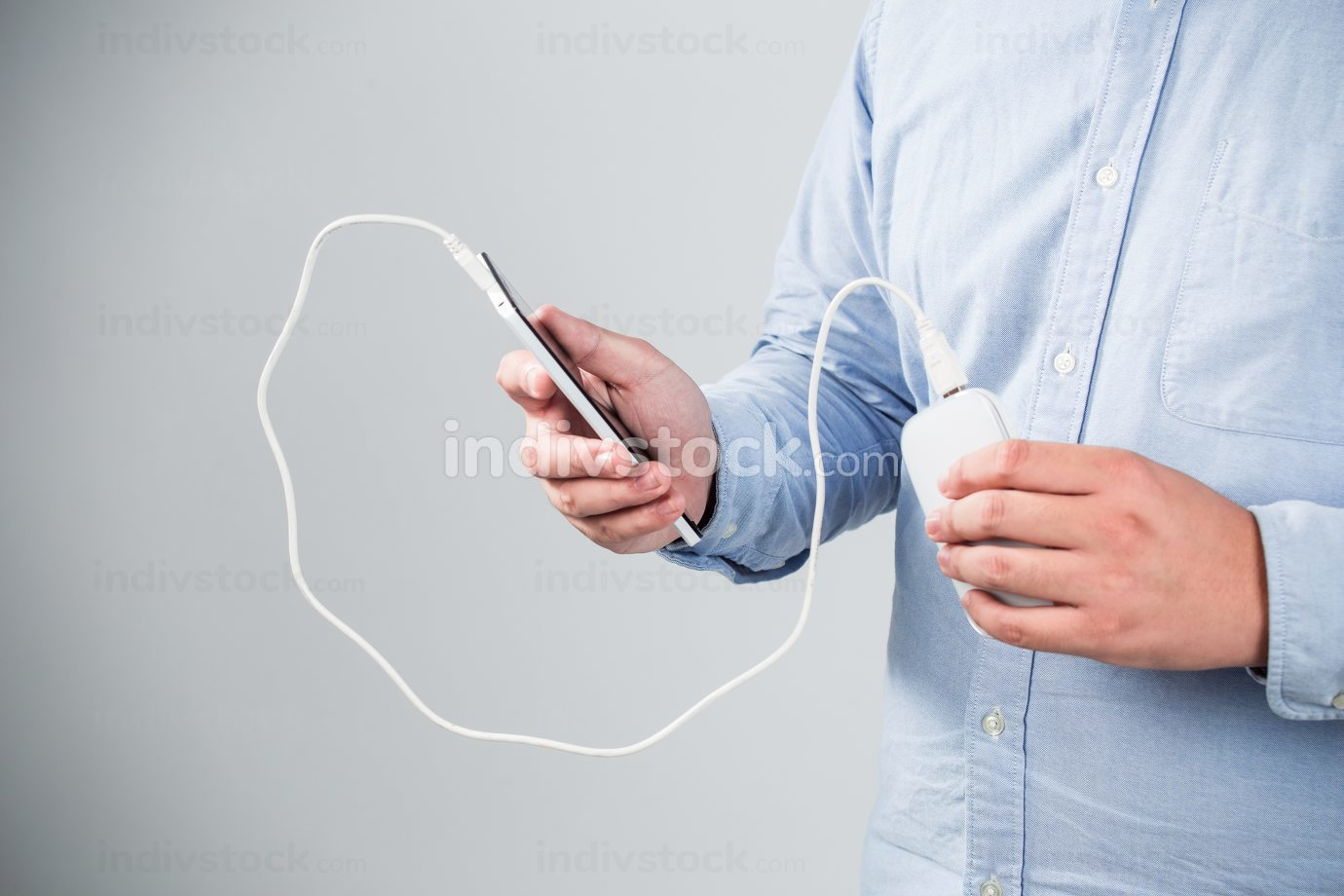 man is charging smartphone