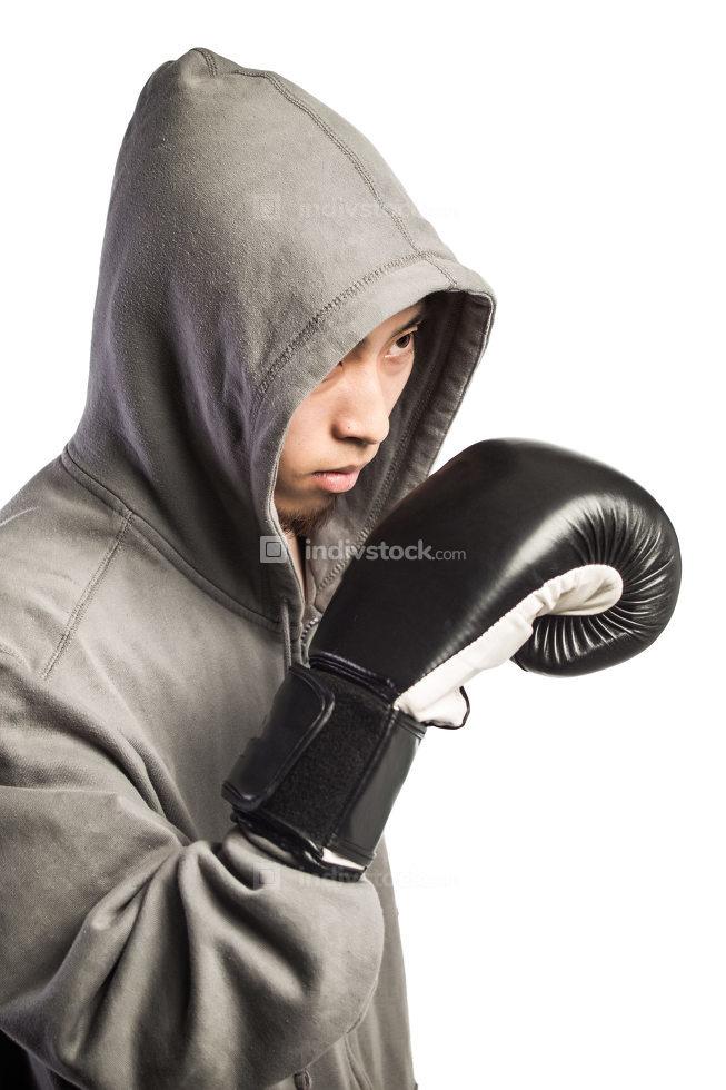 man wearing hood in boxing gloves