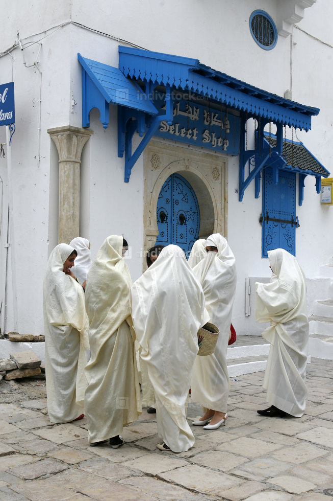 March, 2009, Tunisian Muslim Women in traditional Tunisia clothes in the Old Town of Sidi Bou Said near the City of Tunis