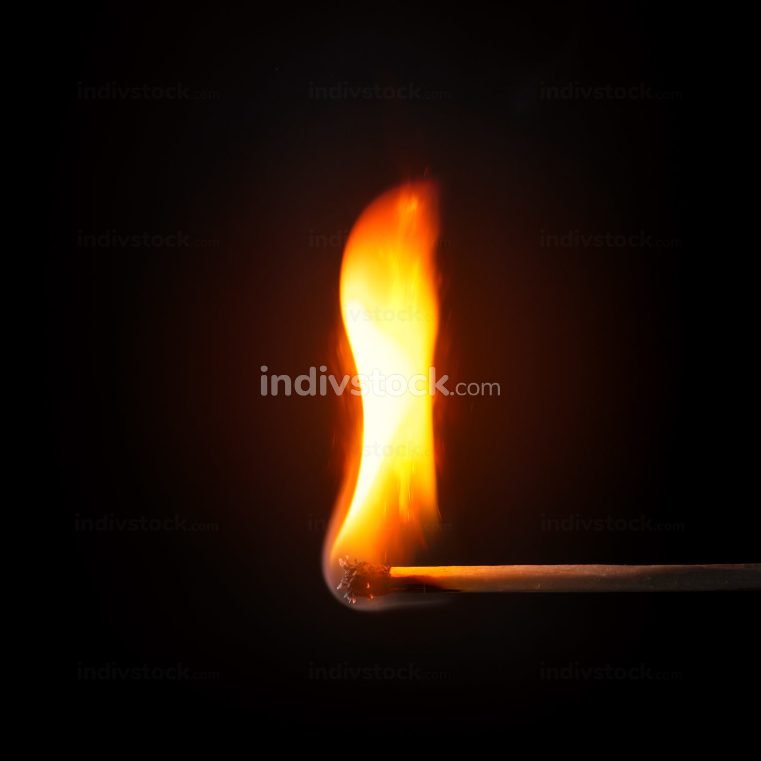 match stick flame in front of a black background