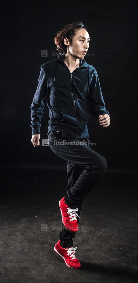 Portrait of an young man jumping in air