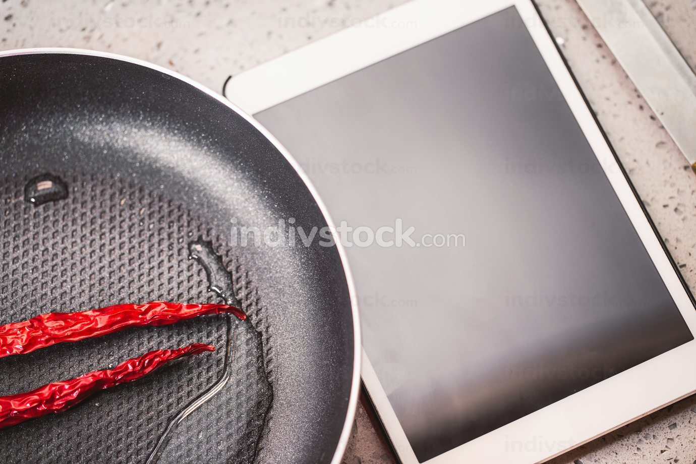 Red Chilli Peppers in a Frying Pan
