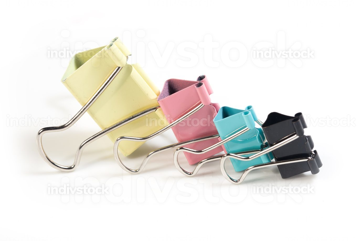 Set of four paper clip isolated on white