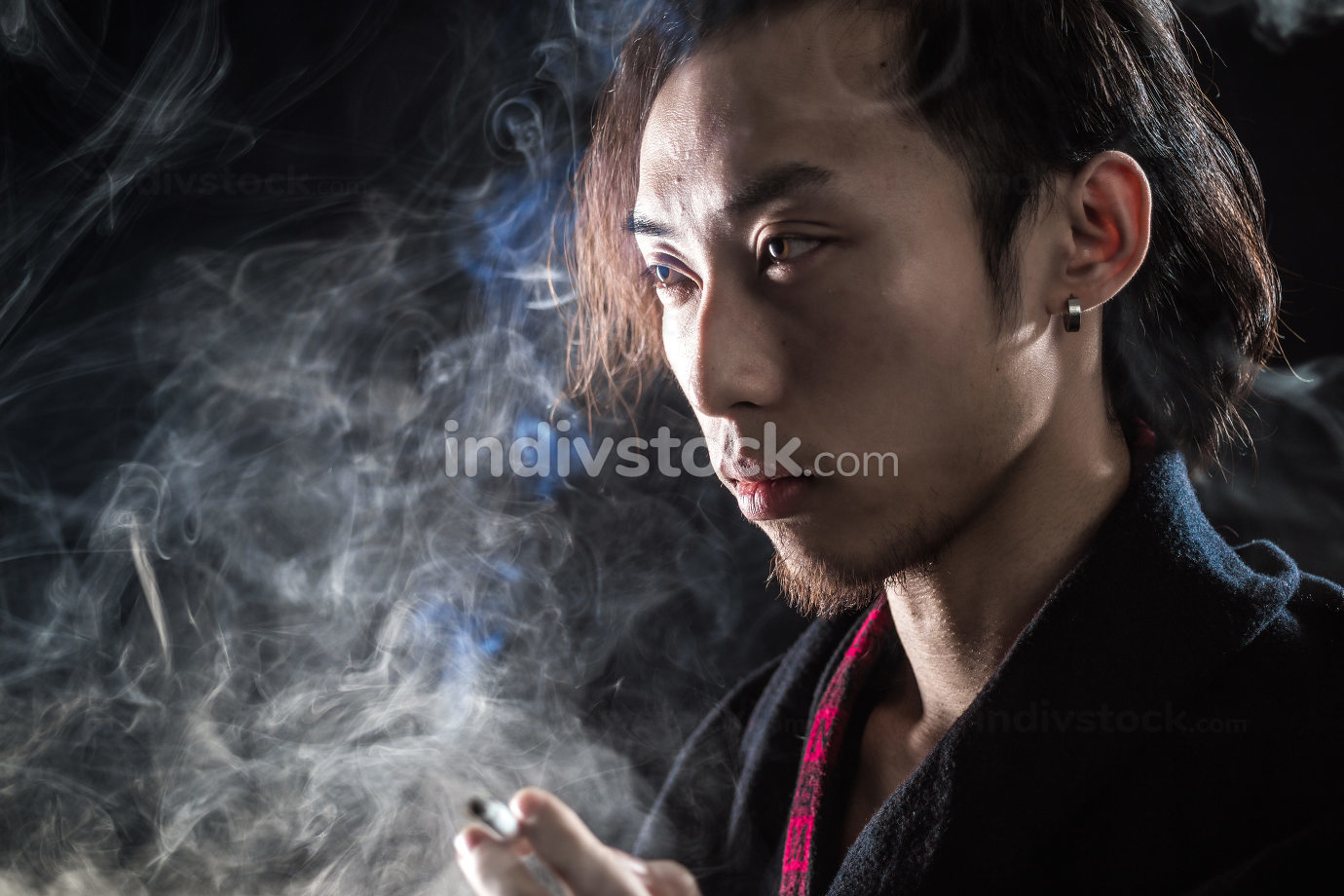 Side view of  man is smoking