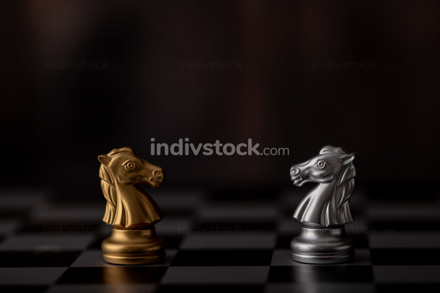 silver and gold horse of the chess in the game