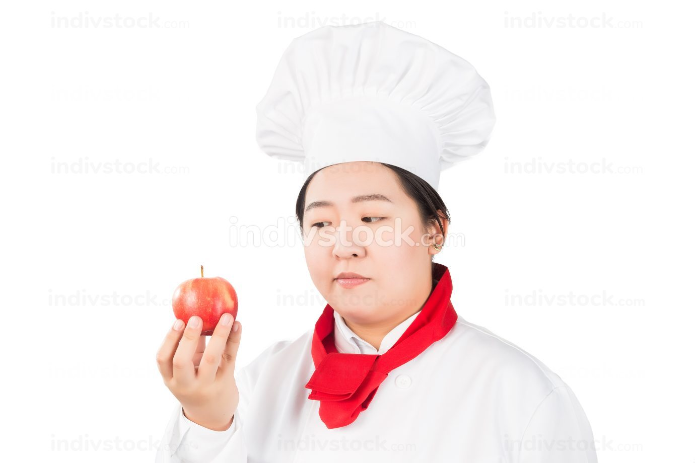 smiling female chef, holding a red apple