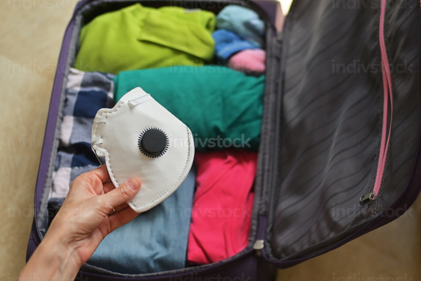 Travel Bag Packed With Clothes, And Medical Masks