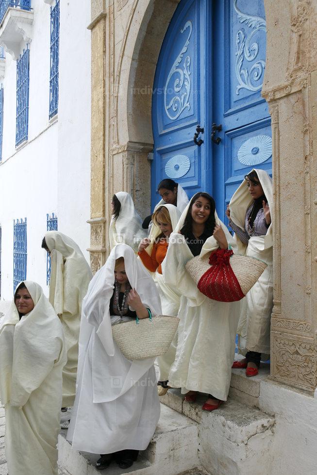 Tunisian Muslim Women in traditional Tunisia clothes in the Old Town of Sidi Bou Said,Tunisia, Sidi Bou Said, March, 2009