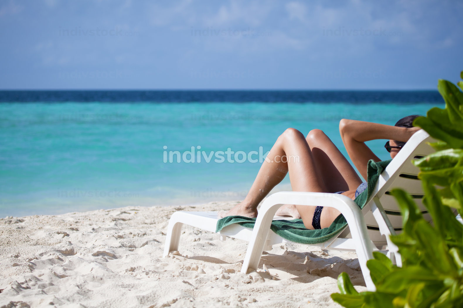 Woman on a lounger on the beach