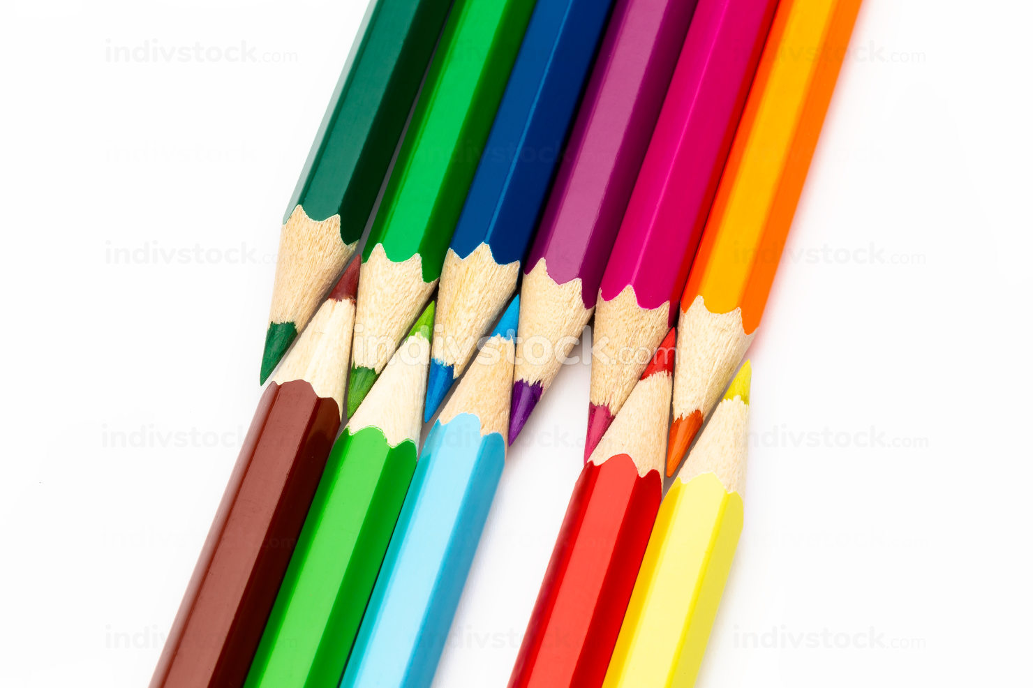 Wooden colored pencils of different colors on a white background