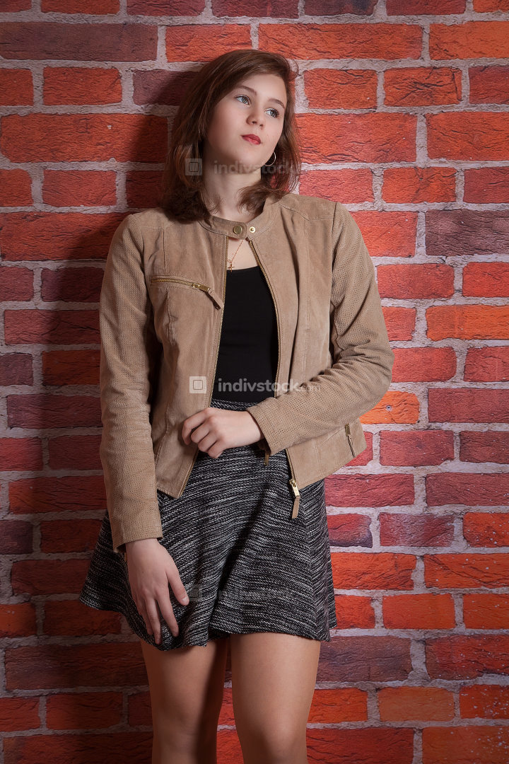 Young woman is standing on the wall