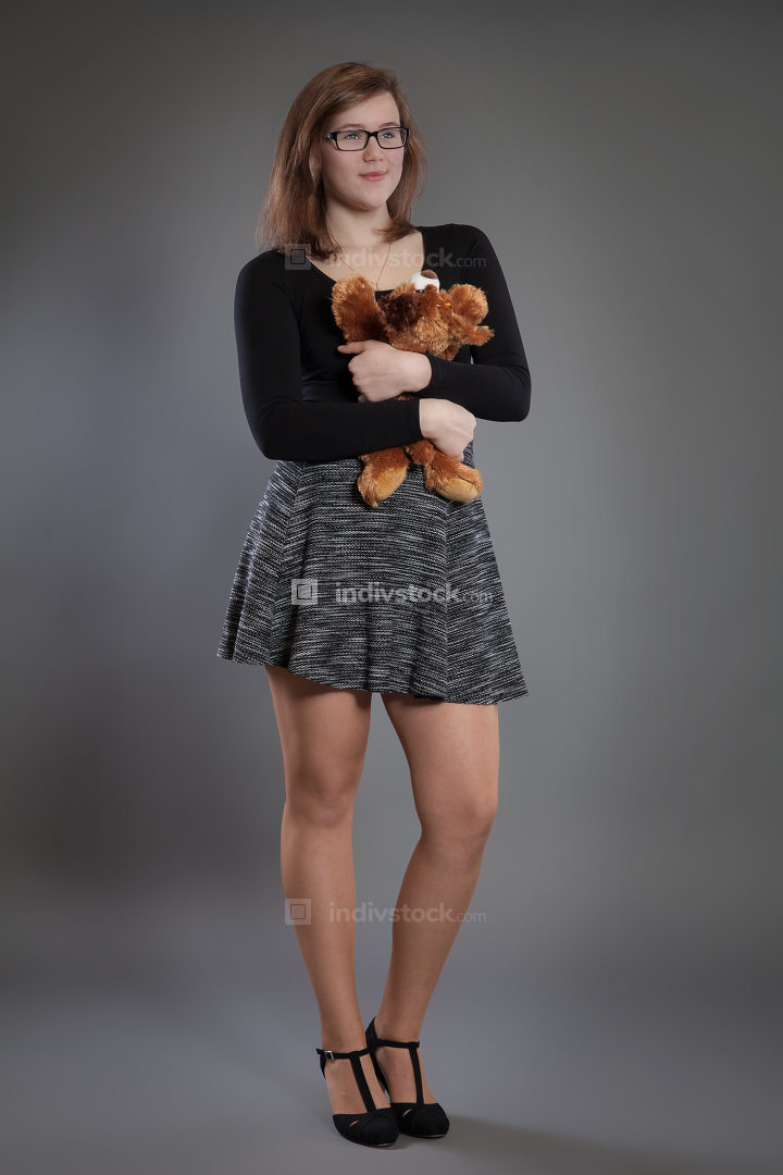 Young woman with a soft toy