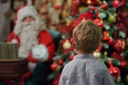 A Boy with Cochlear Implants and Santa Claus in Studio