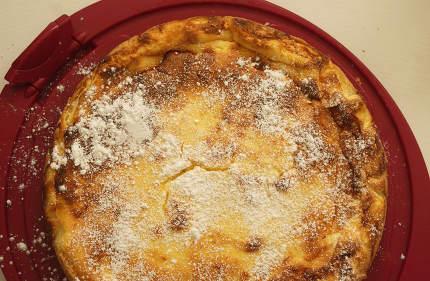 a homemade cheesecake with powdered sugar