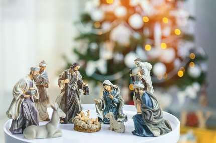 Christmas Manger scene with figurines including Jesus, Mary, Joseph, sheep and wise men. Focus on mother