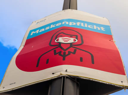 German Schleswig-Holstein, Kiel, German sign during coronavirus telling to wear a face mask for protection during the 2020/2021 corona pandemic