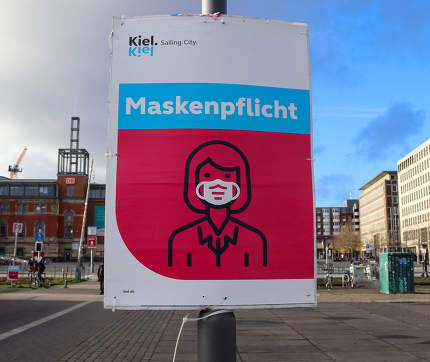 German Schleswig-Holstein, Kiel, sign during coronavirus telling to wear a face mask for protection during the 2020/2021 corona pandemic