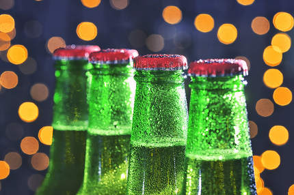 Green Bottle Of Beer and Holiday Glitter Background