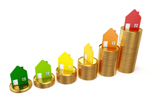 increasing real estate symbolic house on golden coins 3d-illustr