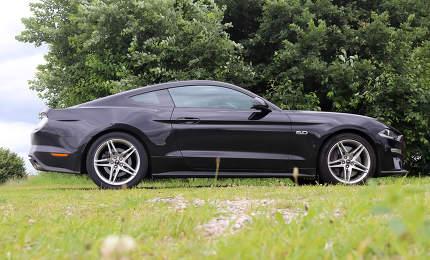 Kiel, Germany - 15.10.2020: Black Ford Mustang 5.0 model 2018 sports car