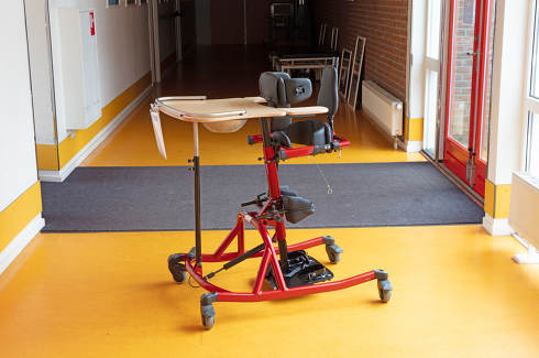 Special chair for disabled children, chair in which a child can stand in, school