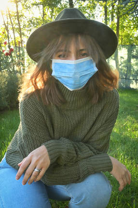 Woman Wearing Medical Mask in Garden