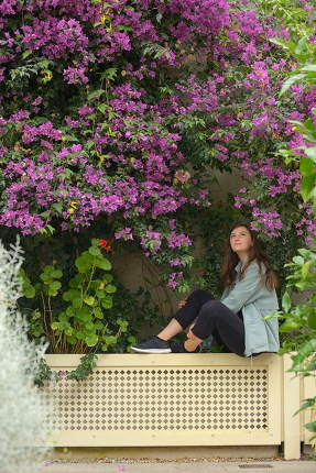Young girl portrait and bougainvillea flowers