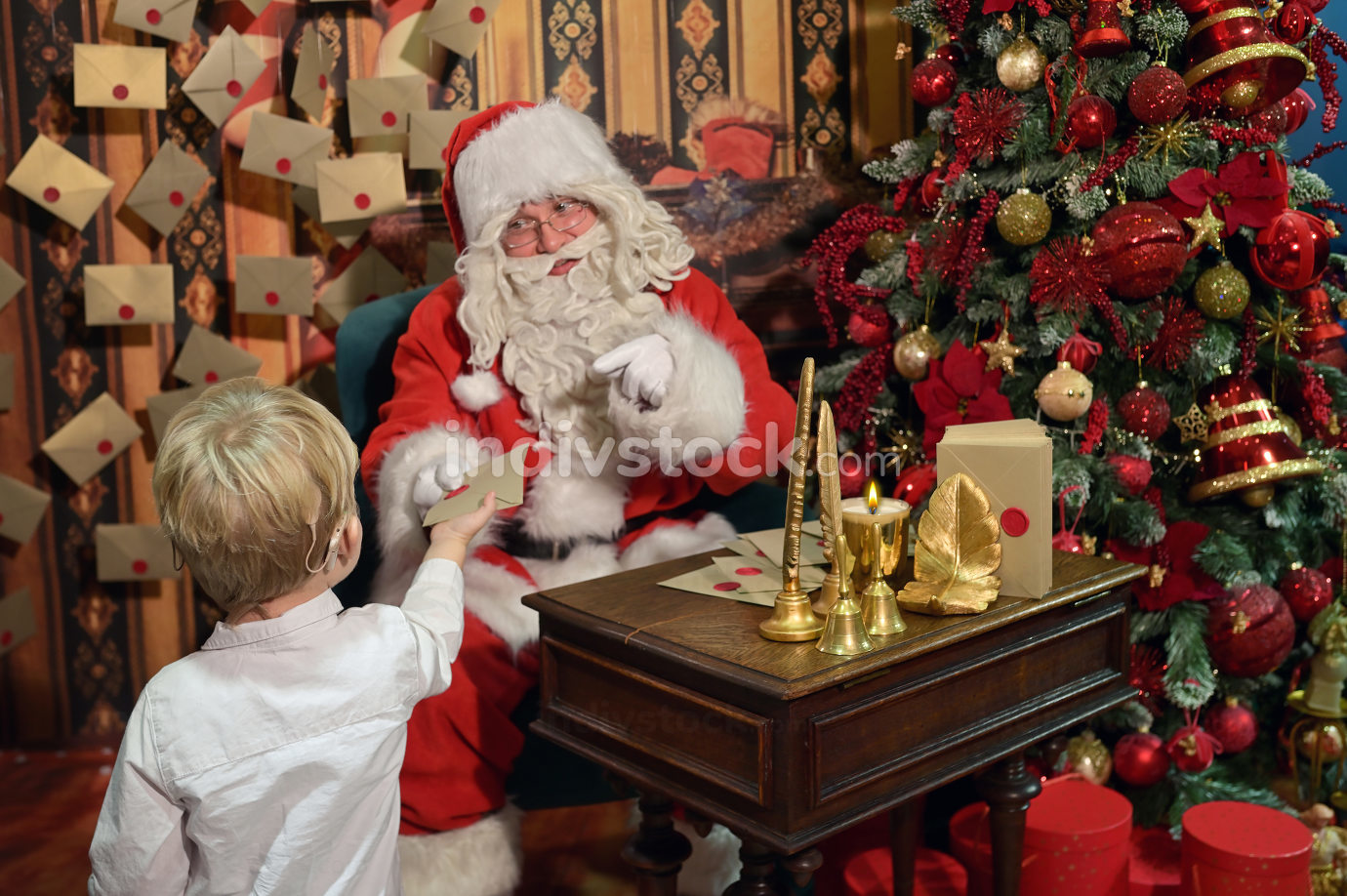 A Boy with Cochlear Implants and Santa Claus
