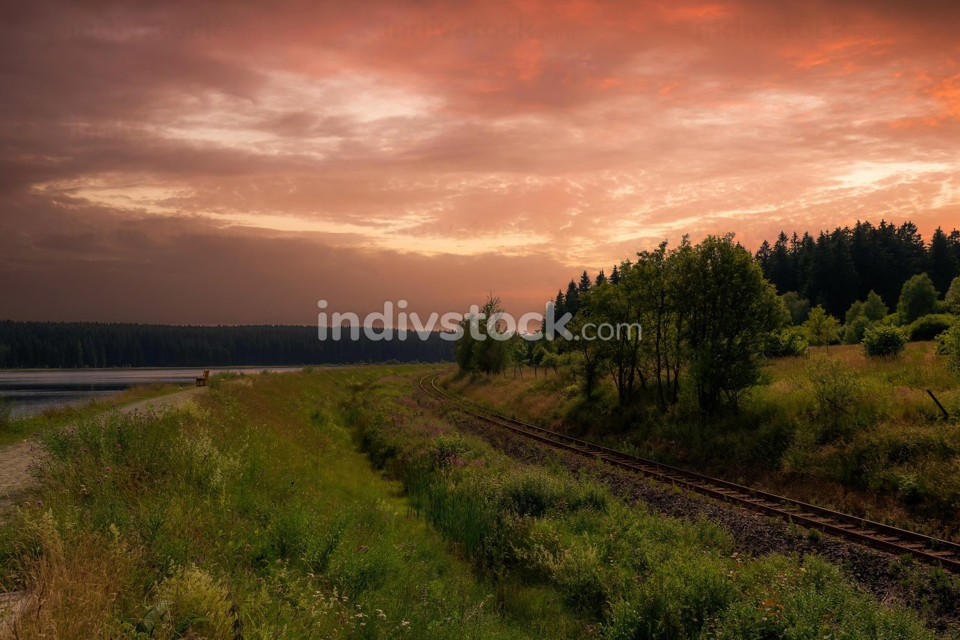 a landscape with railway line in the sunset