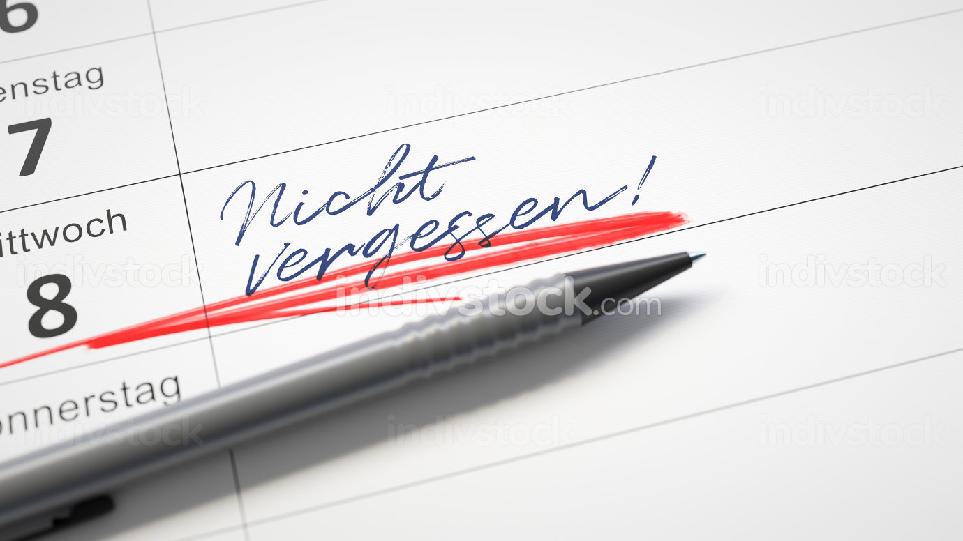 calendar with a red pen and the word do not forget in german lan