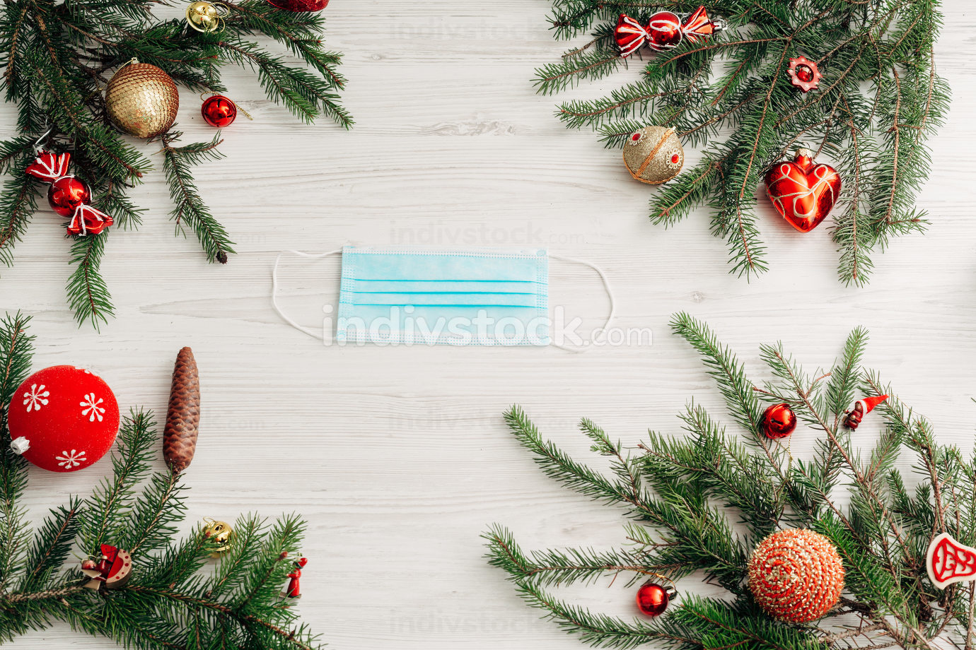 Christmas Composition with Mask on a White Wooden Table with Copy Space
