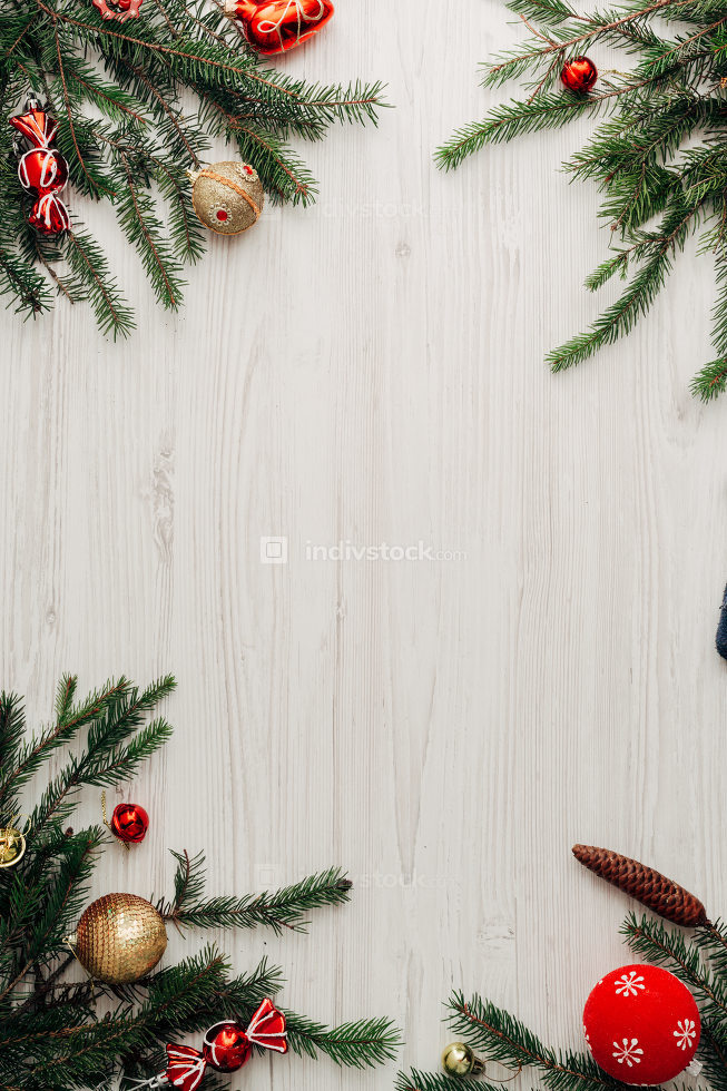 Christmas Red Decorations on a White Wooden Table with Copy Space