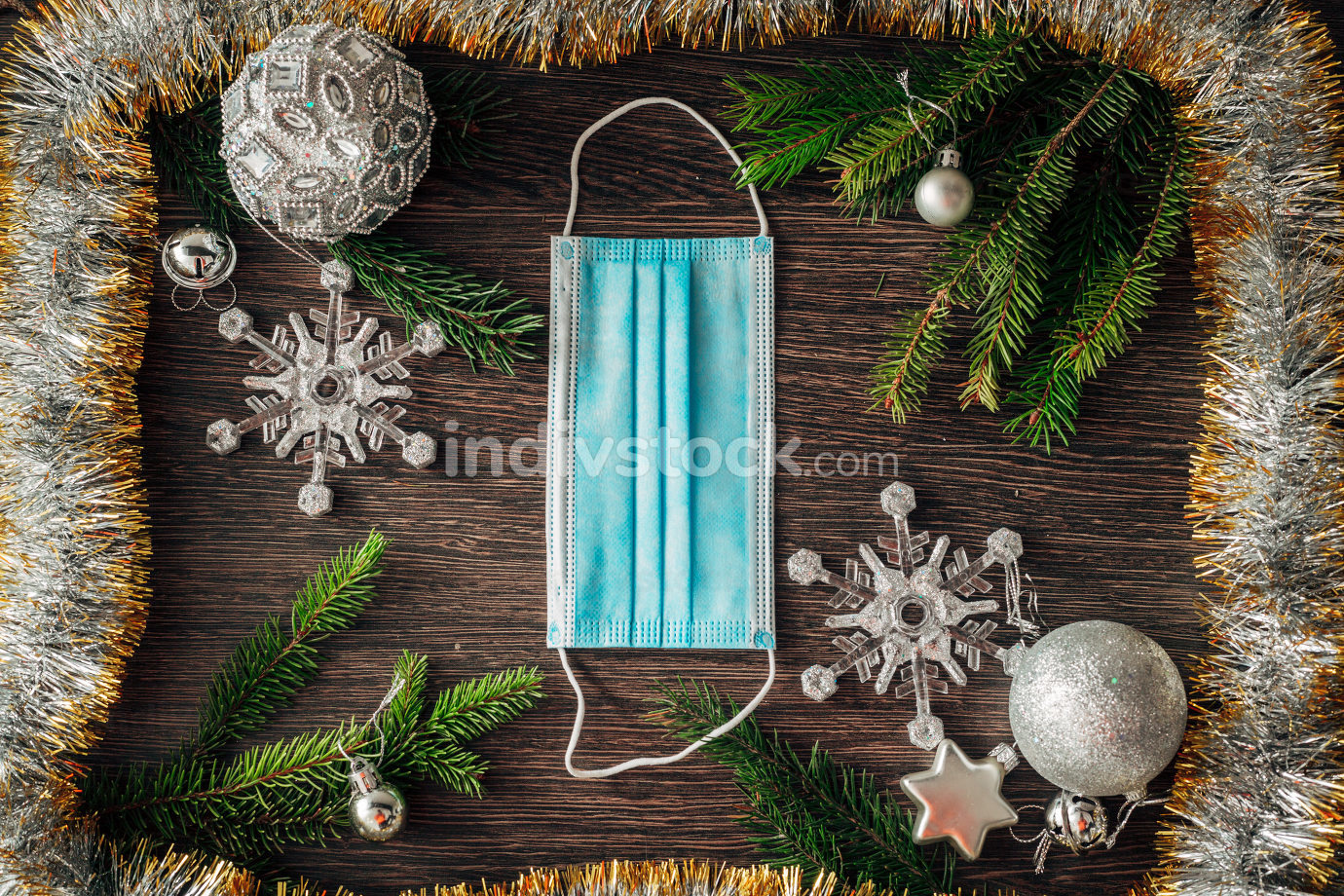 Christmas Tree Branches and Snowflakes on a Brown Background with Copy Space