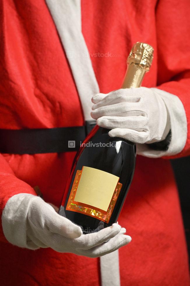 Conceptual Santa Claus Celebrating With Champagne Bottle