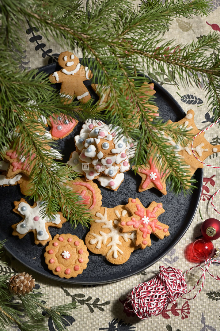 Gingerbread Christmas Cookie on Plate and Pine Brunches