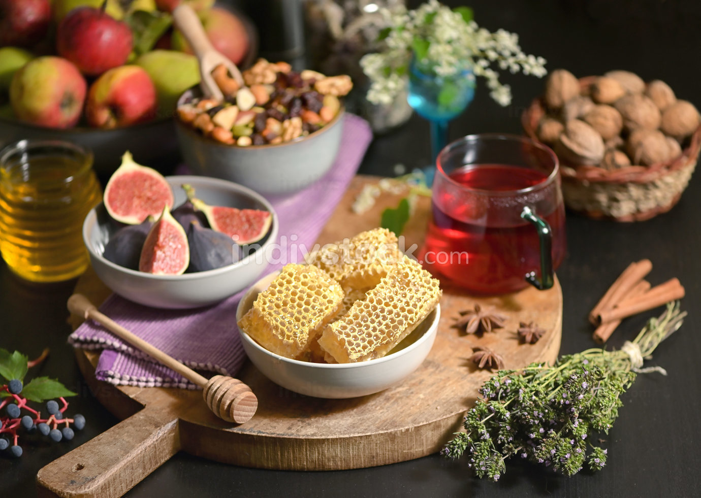 Honey, Honeycomb, Tea, Dried Fruits and Figs on Autumn Table