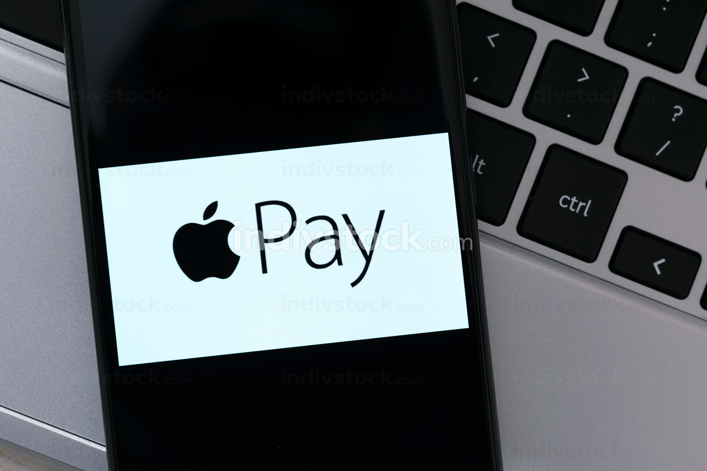 Krakow, Poland - October 20, 2020:  Apple Pay sign on the smartphone screen in close-up