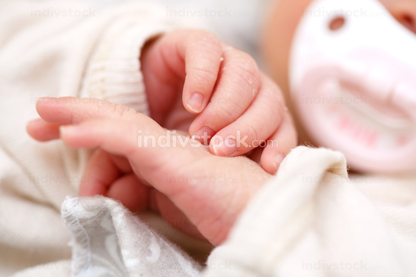 small fingers, hands of a newborn baby close-up. small depth of focus area