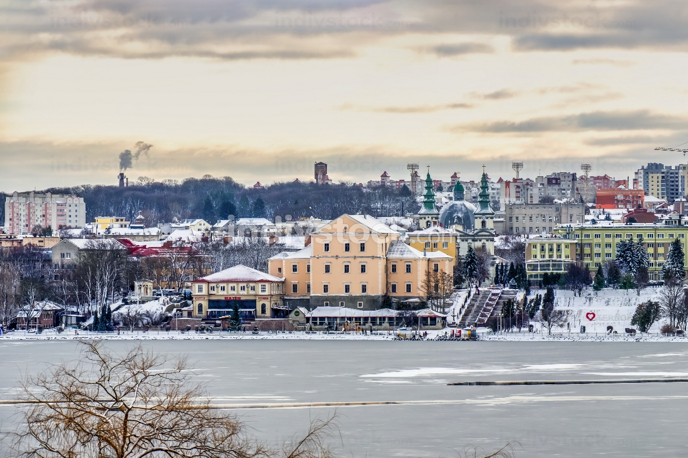 Ternopil, Ukraine 01.05.2020. Panoramic view of Ternopil pond and castle in Ternopol, Ukraine, on a snowy winter morning