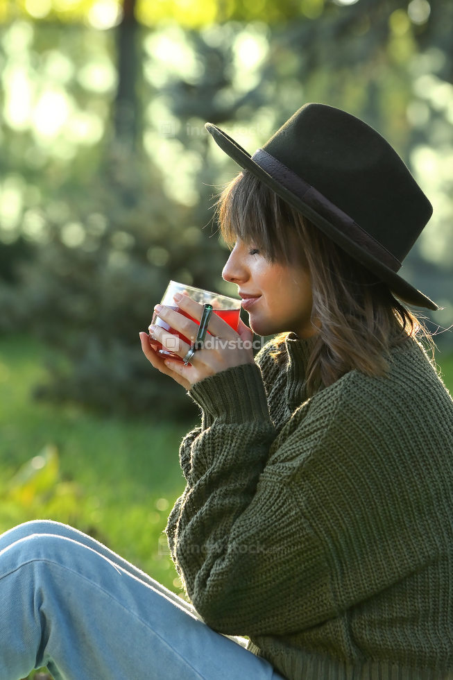 Woman Hold Hot Tea Cup in Nature
