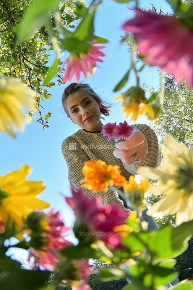Young Girl with Bouquet Below View of Flowers