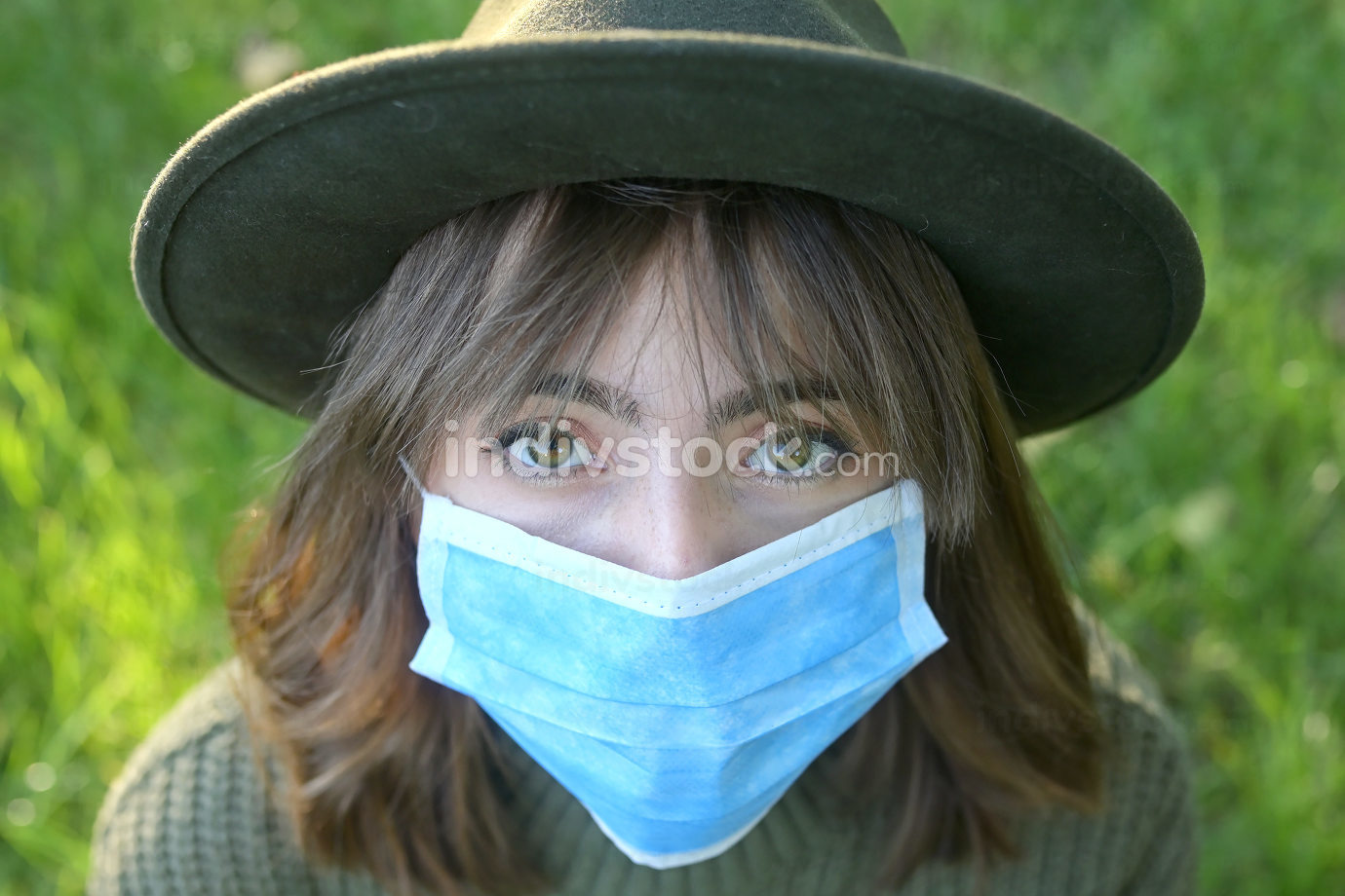 Young Woman With Medical Mask in Nature