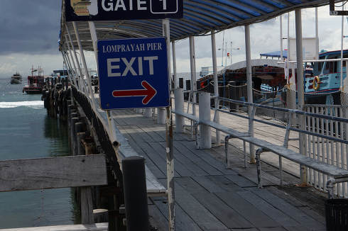 a exit sign at for departures at the empty Mae Haad Pier at May 8, 2021, while Thailand wide lockdowns, in Koh Tao Thailand