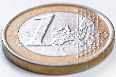 A yellow one-euro coin isolated on a white background. White background